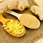 ginger_root_on_a_napkin_on_a_burlap_background_wooden_board